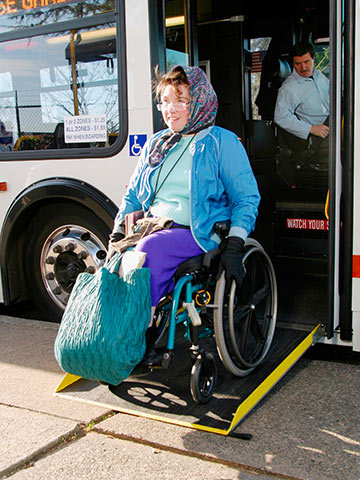 Photo of rider in wheelchair exiting the bus using the ramp