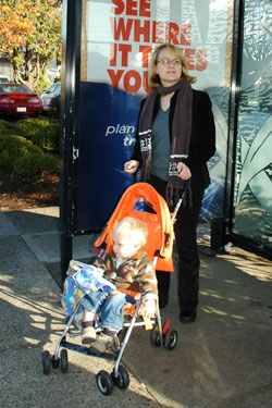 Photo of woman boarding MAX with child and stroller
