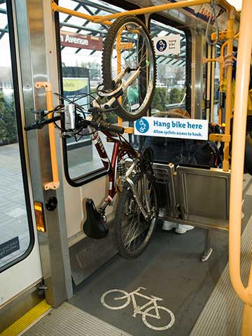 Photo of bike hanging from bike hook on MAX train
