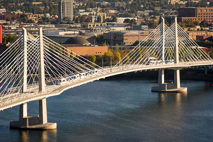 MAX Orange Line trains on the Tilikum Crossing