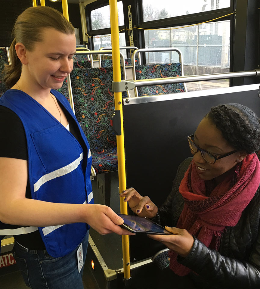 Woman taking a survey on a bus